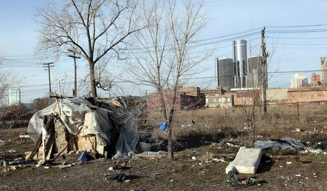 A makeshift homeless persons structure is seen, with General Motors Corp. world headquarters headquarters in the background, from an mostly