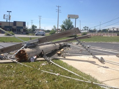 A downed power pole from along Richmond St. in Appleton, near Ridgeview Dr., is seen in the parking lot of KimCentral Credit Union, Aug. 8, 2013. (Photo from: FOX 11).