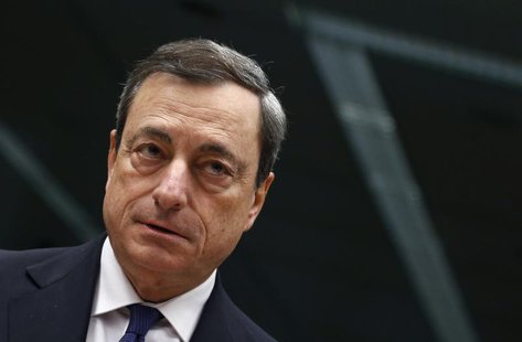 European Central Bank (ECB) President Mario Draghi looks on at the start of an Eurozone finance ministers meeting in Brussels November 14, 2
