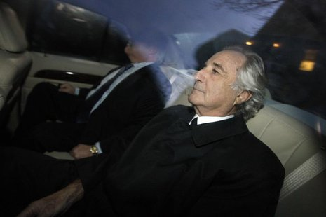 Bernard Madoff (R), who confessed to defrauding investors of 50 billion dollars, arrives home after a hearing at Federal Court, in New York,