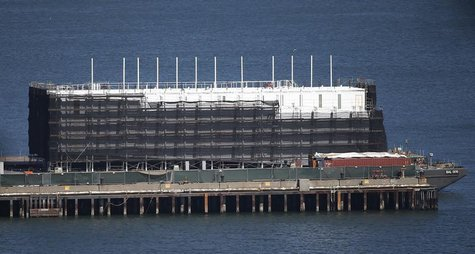 A barge built with four levels of shipping containers is seen at Pier 1 at Treasure Island in San Francisco, California October 28, 2013. Ho