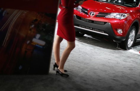 A model rocks her stilettos at the Toyota booth at the 2013 Los Angeles Auto Show in Los Angeles, California, November 21, 2013. REUTERS/Luc