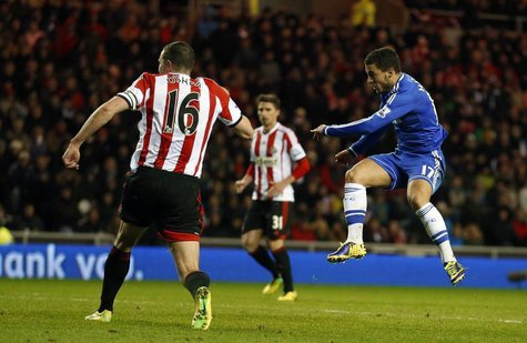 Chelsea's Eden Hazard (R) scores against Sunderland during their English Premier League soccer match at the Stadium of Light in Sunderland,
