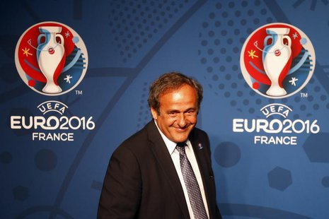 Michel Platini, UEFA President walks in front of the UEFA EURO 2016 logo at a news conference in Paris June 26, 2013. REUTERS/Charles Platia