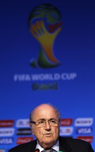 FIFA President Sepp Blatter speaks during a news conference ahead of the 2014 World Cup draw at the Costa do Sauipe resort in Sao Joao da Ma