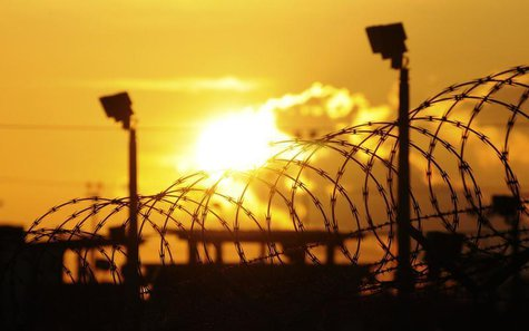"The sun rises over the U.S. detention center ""Camp Delta"" at US Naval Base Guantanamo Bay in Cuba October 18, 2012 in this photo reviewed by"