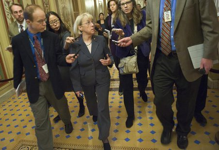 U.S. Senator Patty Murray (D-WA) (C), co-chairman of the 'super committee' on debt reduction, speaks to reporters after meeting with the Dem