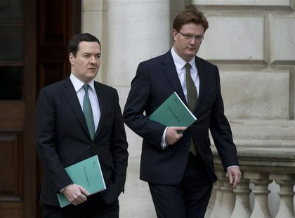 Britain's Chancellor of the Exchequer George Osborne (L), and his deputy the Chief Secretary to the Treasury Danny Alexander, leave the Trea