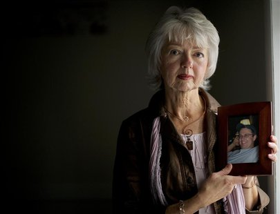 Terri Roberts, the mother of Amish school shooter Charles Roberts, holds a photograph of her son at New Covenant Community Church in Delta,