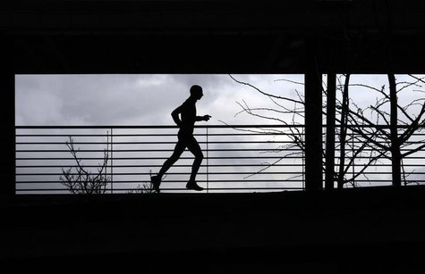 A man runs at the Athletic stadium in Florence February 16, 2011. REUTERS/Alessandro Bianchi