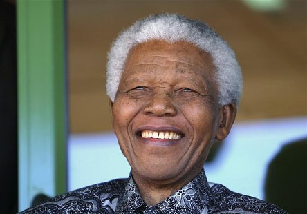 Nelson Mandela smiles as he watches the coronation ceremony of Bafokeng's King Leruo Tshekedi Molotlegi at a sports stadium in Phokeng, 120