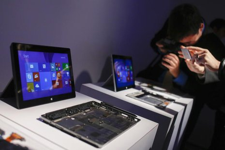 Members of the media take pictures of Surface 2 tablets during the launch of the Microsoft Surface 2 tablets in New York September 23, 2013.
