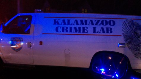 Crime Lab van called in to investigate, parked in the reflected glow of police lights.