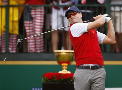 U.S. golfer Zach Johnson tees off during the Singles matches for the 2013 Presidents Cup golf tournament at Muirfield Village Golf Club in D