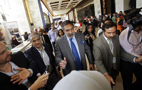 India's Commerce Minister Anand Sharma (C) arrives at the ninth World Trade Organization (WTO) Ministerial Conference in Nusa Dua, on the In