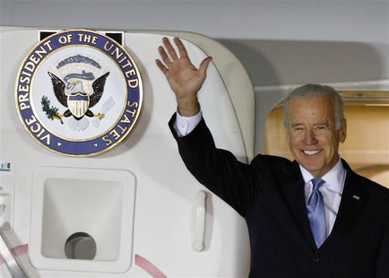 U.S. Vice President Joe Biden waves upon his arrival at Osan Air Base, south of Seoul December 5, 2013. REUTERS/Kim Hong-Ji
