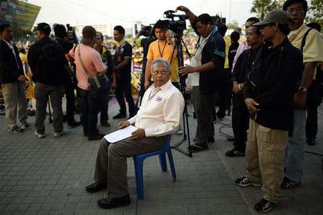 Protest leader Suthep Thaugsuban prepares to address anti-government protesters as they take part in birthday celebrations for Thailand's re