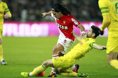 FC Nantes' Olivier Veigneau challenges AS Monaco's Radamel Falcao (L) during their French Ligue 1 soccer match at the Beaujoire in Nantes, N