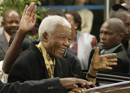 Former South African President Nelson Mandela waves as he leaves after casting his vote at a polling station in Houghton, Johannesburg, in t