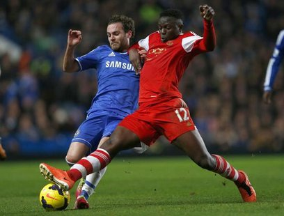 Chelsea's Juan Mata (L) challenges Southampton's Victor Wanyama during their English Premier League soccer match against Southampton at Stam