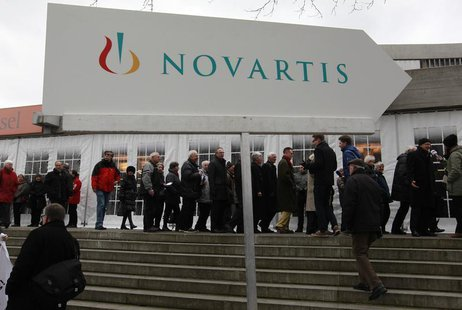 Shareholders queue to enter the St.Jakob Halle for Swiss drug maker Novartis annual general meeting in Basel February 22, 2013. REUTERS/Arnd
