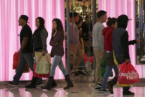 Shoppers walk inside the Glendale Galleria in Glendale, California November 29, 2013. REUTERS/Jonathan Alcorn