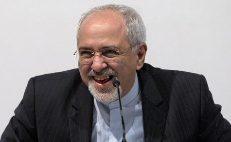Iranian Foreign Minister Mohammad Javad Zarif smiles as he speaks to the media at the International Conference Centre of Geneva in Geneva No