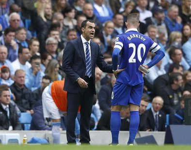 Everton's manager Roberto Martinez (L) talks with Ross Barkley during their English Premier League soccer match against Manchester City at t