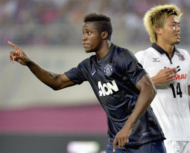 Manchester United's Wilfried Zaha (L) celebrates after scoring during their friendly soccer match against Cerezo Osaka in Osaka, western Jap