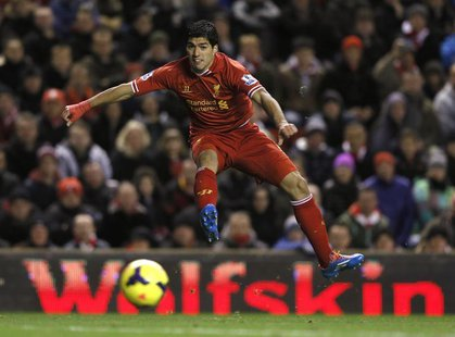 Liverpool's Luis Suarez takes a shot on goal against Norwich City during their English Premier League soccer match at Anfield in Liverpool,