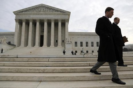 People walk outside the U.S. Supreme Court in Washington December 3, 2013. REUTERS/Jonathan Ernst