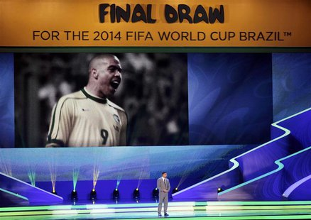 Former Brazil soccer player Ronaldo speaks on stage during the draw for the 2014 World Cup at the Costa do Sauipe resort in Sao Joao da Mata