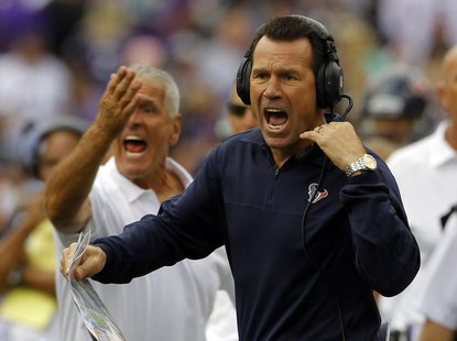 Houston Texans head coach Gary Kubiak yells to his team during their NFL football game against the Baltimore Ravens in Baltimore, Maryland S