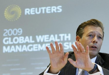 REYL & Cie SA Chief Executive Officer Francois Reyl gestures during the Reuters Global Wealth Management Summit in Geneva October 7, 2009. R