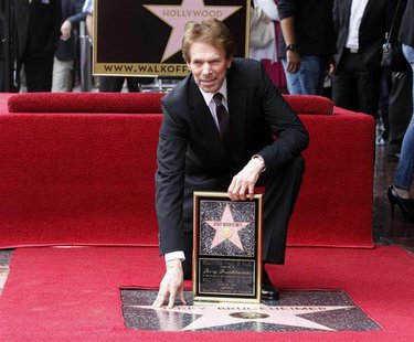 Film and television producer Jerry Bruckheimer poses with his star on the Hollywood Walk of Fame in Hollywood June 24, 2013. REUTERS/Fred Pr