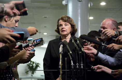 U.S. Senator Dianne Feinstein (D-CA) (C), chairman of the Senate Select Committee on Intelligence, speaks to reporters after departing a ful