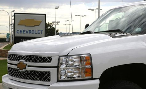 The sign at a General Motors Chevrolet dealer is seen behind a Chevrolet pickup truck in Golden, Colorado September 4, 2013. REUTERS/Rick Wi