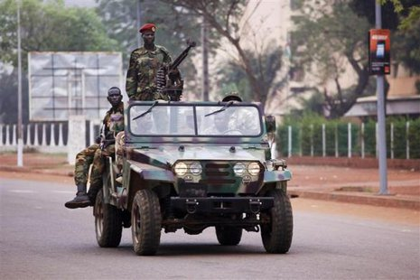 Seleka soldiers drive along a road in Bangui.  REUTERS/Emmanuel Braun