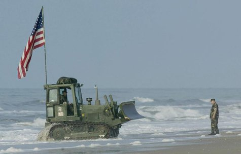 A bulldozer makes its way onto Onslow beach at Camp Lejeune, North Carolina, May 26, 2003 after being unloaded from a landing craft. REUTERS