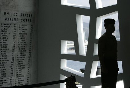 "A U.S. Marine stands at attention at the ""Remembrance Wall"" in the Shrine Room on the USS Arizona Memorial during the 71st anniversary of th"