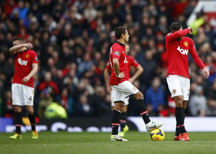 (L to R) Manchester United's Phil Jones, Javier Hernandez and Robin van Persie react during their English Premier League soccer match agains