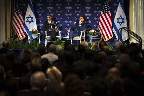 U.S. President Barack Obama (L) speaks with Israeli-American media tycoon Haim Saban in front of a live audience about negotiations with Ira