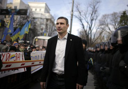 Vitali Klitschko, heavyweight boxing champion and UDAR (Ukrainian Democratic Alliance for Reform) party leader, walks past supporters and po