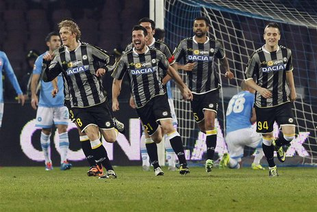 Udinese's Dusan Basta (L) celebrates with his team mates after scoring against Napoli during their Italian Serie A soccer match at San Paolo