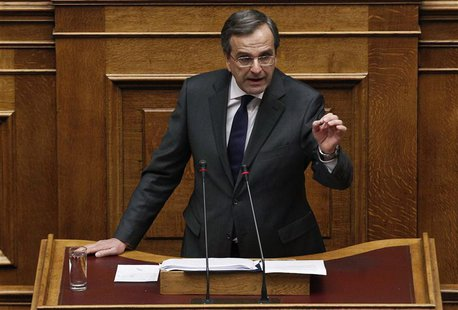 Greece's Prime Minister Antonis Samaras delivers a speech during a parliament session where lawmakers vote on the 2014 budget in Athens Dece