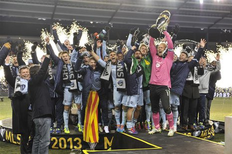 Dec 7, 2013; Kansas City, KS, USA; Sporting KC goalkeeper Jimmy Nielsen (1) raises the MLS Cup with his team after the 2013 MLS Cup against