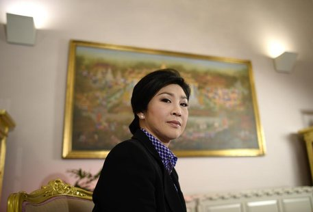 Thai Prime Minister Yingluck Shinawatra poses for a picture during an interview with foreign media at the Government House in Bangkok Decemb