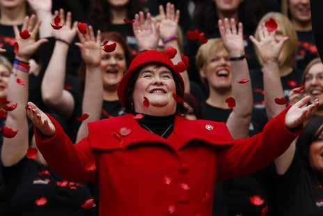 Singer Susan Boyle smiles as poppy's fall over her at a photocall during the launch of the Poppy Scotland appeal in Glasgow, Scotland Octobe