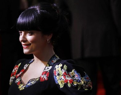 British singer Lily Allen poses as she arrives for the British premiere of Tamara Drew in Leicester Square, central London September 6, 2010
