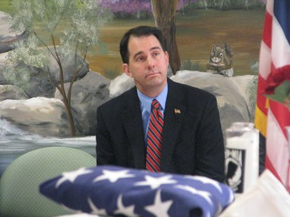 Governor Scott Walker listens during Pearl Harbor commemoration.